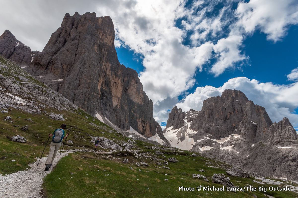 A family hiking the Alta Via 2 in Parco Naturale Paneveggio Pale di San Martino, Dolomite Mountains, Italy.