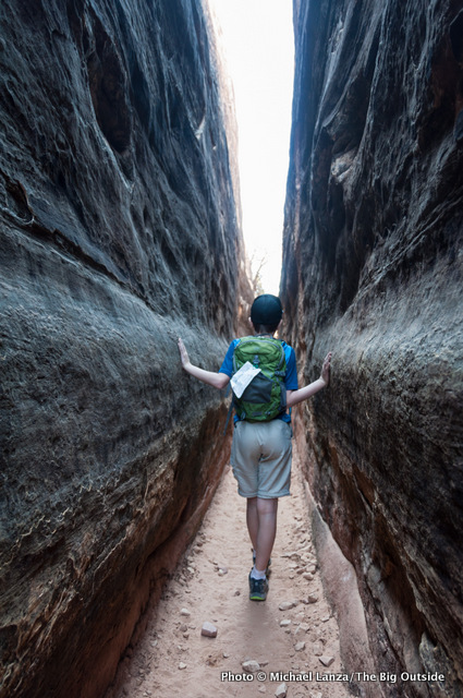 Young boy hiking the Chesler Park Trail, Needles District, Canyonlands National Park, Utah.