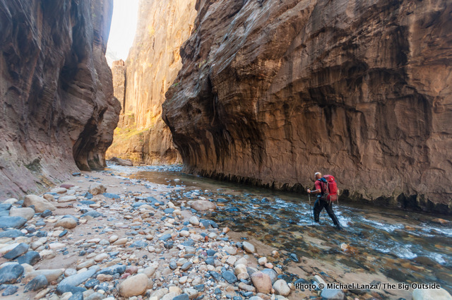 A backpacker on day two in The Narrows, Zion National Park.