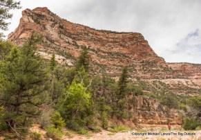 A backpacker on the Woodenshoe Canyon Trail, Dark Canyon Wilderness, Utah.