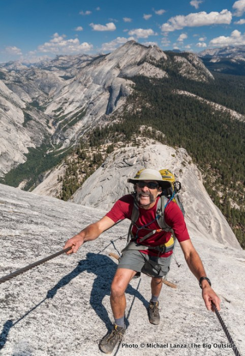 A hiker on Half Dome's cable route in Yosemite National Park.