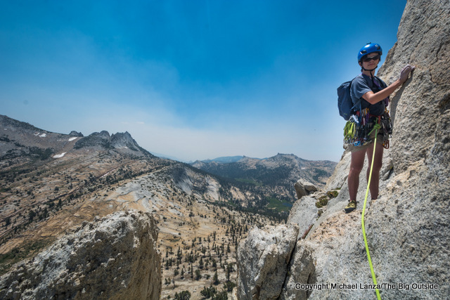 Young rock climber on Cathedral Peak in Yosemite National Park.