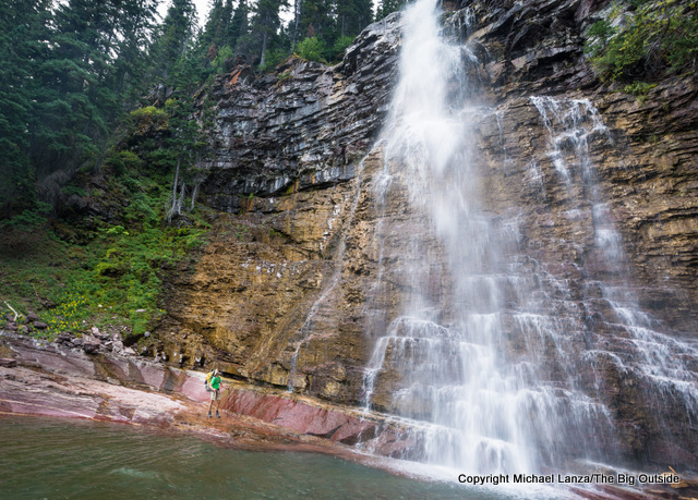 A backpacker at Virginia Falls in Glacier National Park.
