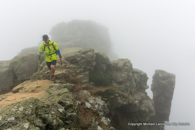 A hiker on the Franconia Ridge Trail on a rainy day, White Mountains, N.H.