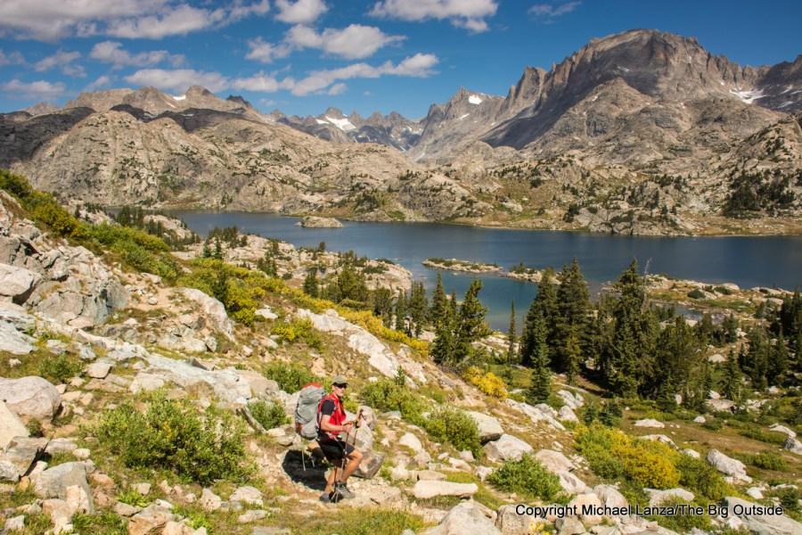 A backpacker hiking to Island Lake in Wyoming's Wind River Range.