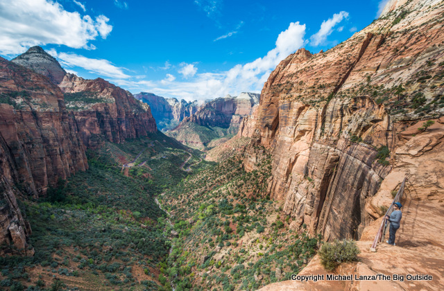 A hiker on the Canyon Overlook Trail in Zion National Park.