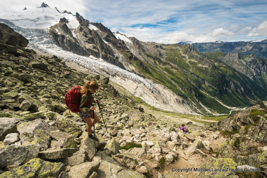 A young teenage girl descending from the Fenetre d'Arpette on the Tour du Mont Blanc in Switzerland.
