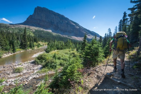 A backpacker in the Belly River Valley, Glacier National Park.