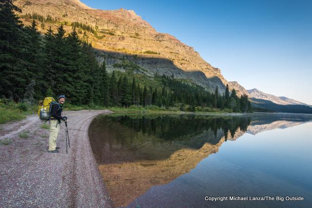 A backpacker at Elizabeth Lake in Glacier National Park.