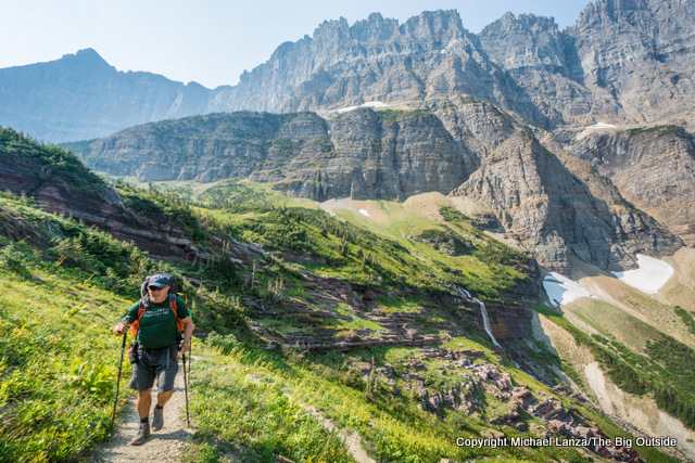 A backpacker hiking toward Piegan Pass in Glacier National Park.