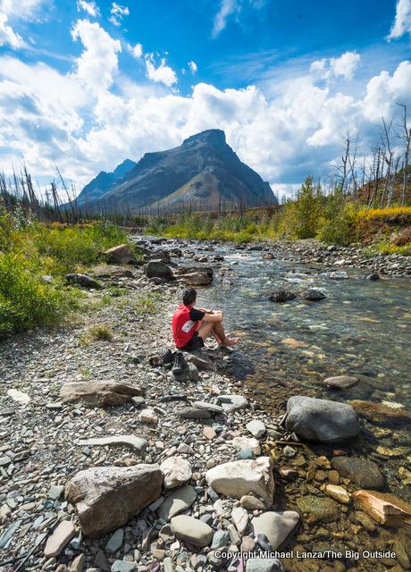 A backpacker at Red Eagle Creek, Glacier National Park.