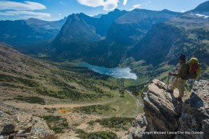 A backpacker above Medicine Grizzly Lake on the CDT in Glacier National Park.