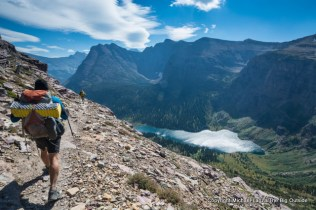 Backpackers above Medicine Grizzly Lake on the CDT in Glacier National Park.