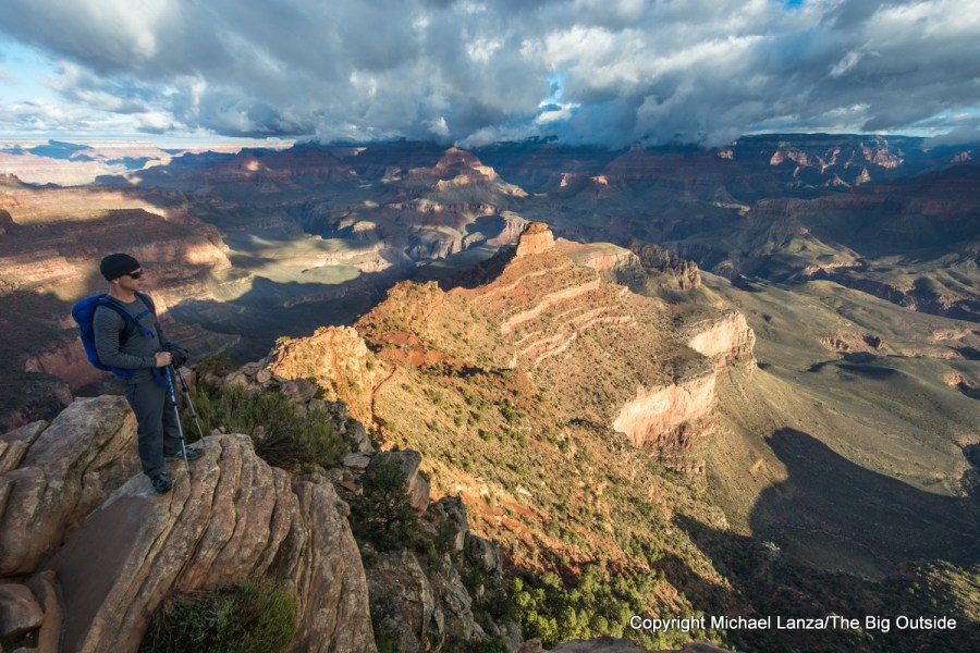 A hiker at Ooh-Ah Point on the upper South Kaibab Trail in the Grand Canyon.