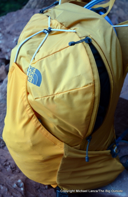 The North Face Chimera 18 with pocket open.
