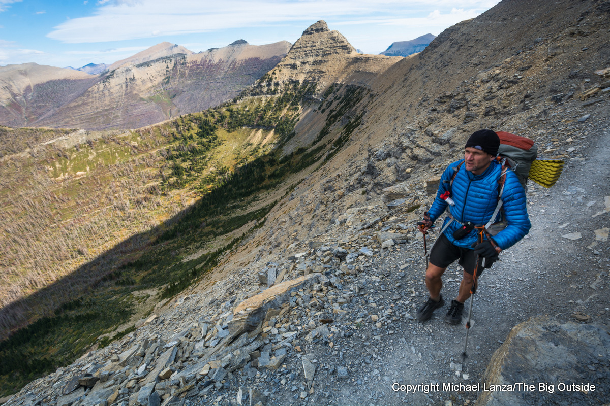A backpacker hiking the Dawson Pass Trail in Glacier National Park.
