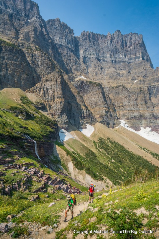 Backpackers hiking the Continental Divide Trail in Glacier National Park.