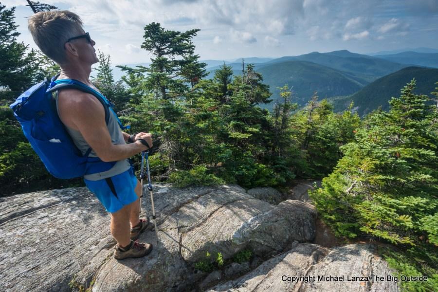 A hiker on the Appalachian Trail in Maine's Mahoosuc Range.
