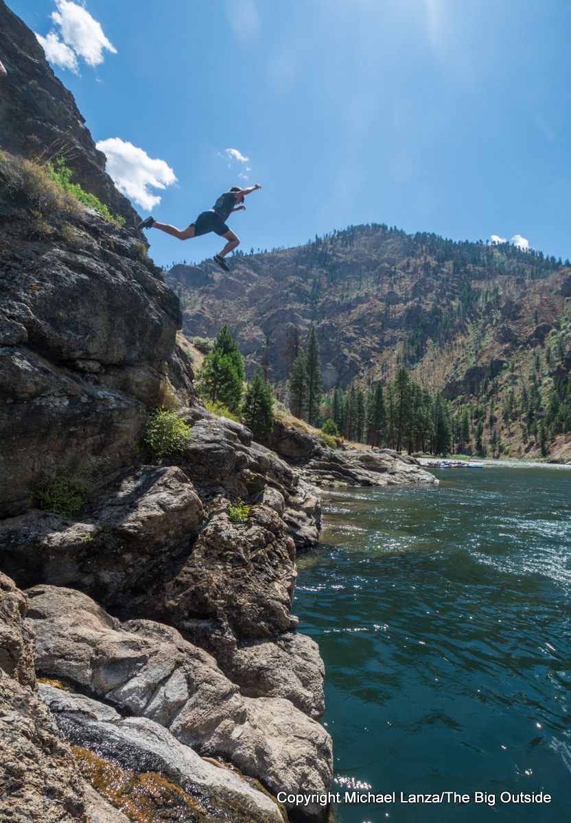 A rafter cliff jumping into Idaho's Middle Fork Salmon River.