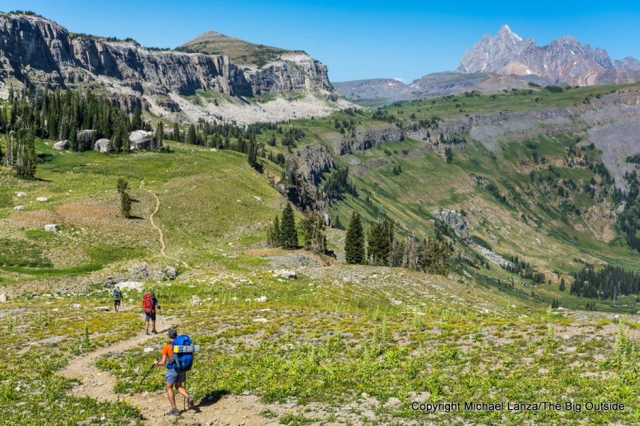 Backpackers on the Teton Crest Trail on Death Canyon Shelf in Grand Teton National Park.