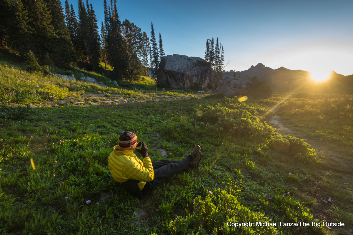 A backpacker at a campsite along the Teton Crest Trail on Death Canyon Shelf, in Grand Teton National Park.
