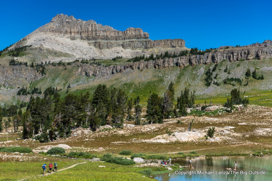Backpackers on the Teton Crest Trail at Sunset Lake, Grand Teton National Park.