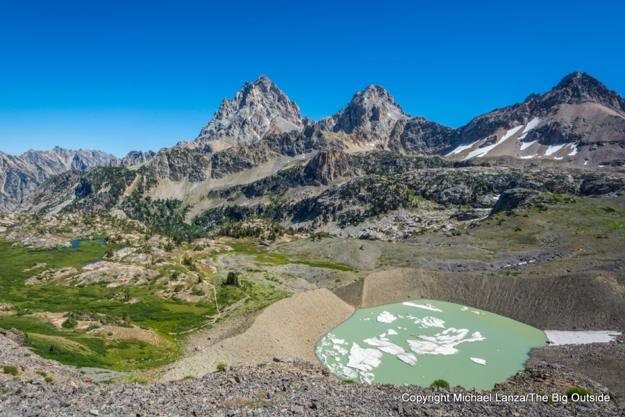 A glacial lake and the Grand, Middle, and South Tetons.