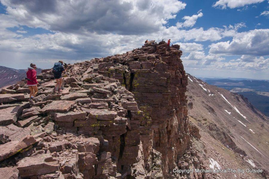 Two teenage girls hiking 13,538-foot Kings Peak, High Uintas Wilderness, Utah