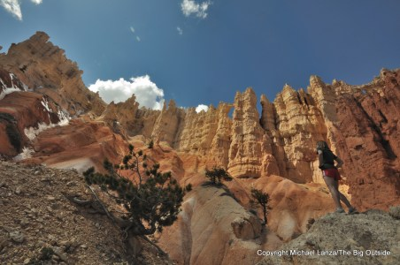 A hiker below the Wall of Windows on the Peek-a-Boo Loop in Bryce Canyon National Park.