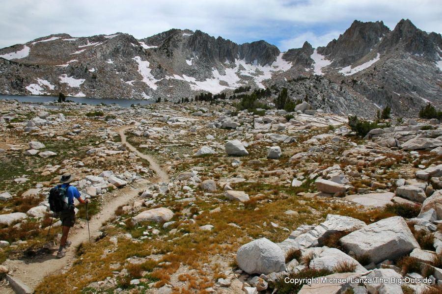 A backpacker on the John Muir Trail hiking toward Silver Pass in the John Muir Wilderness.