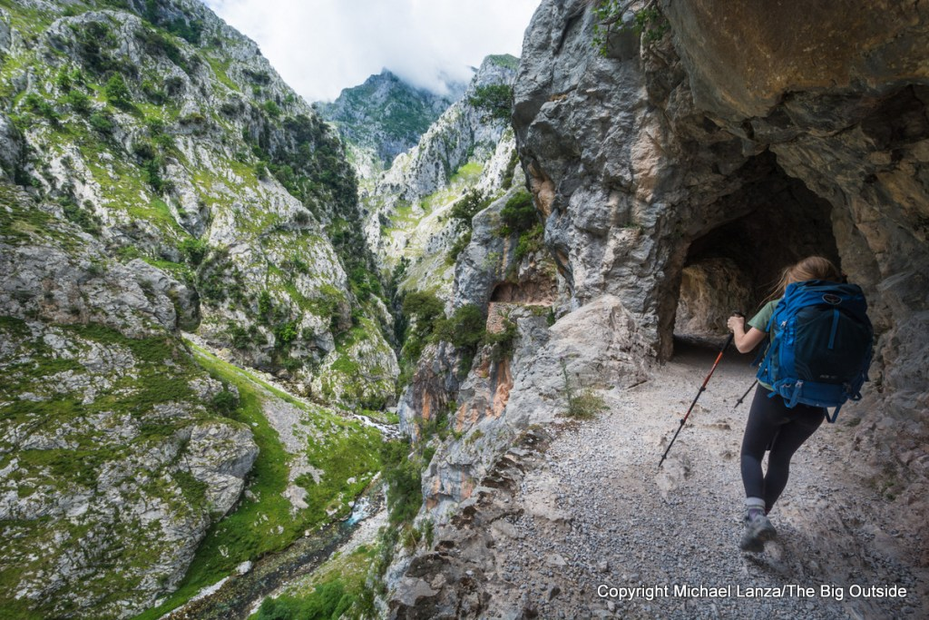 A teenage girl hiking through the Cares Gorge in Spain's Picos de Europa National Park.