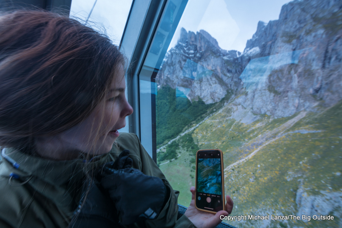 Teenage girl on the Fuente Dé cable car, Picos de Europa National Park, Spain.