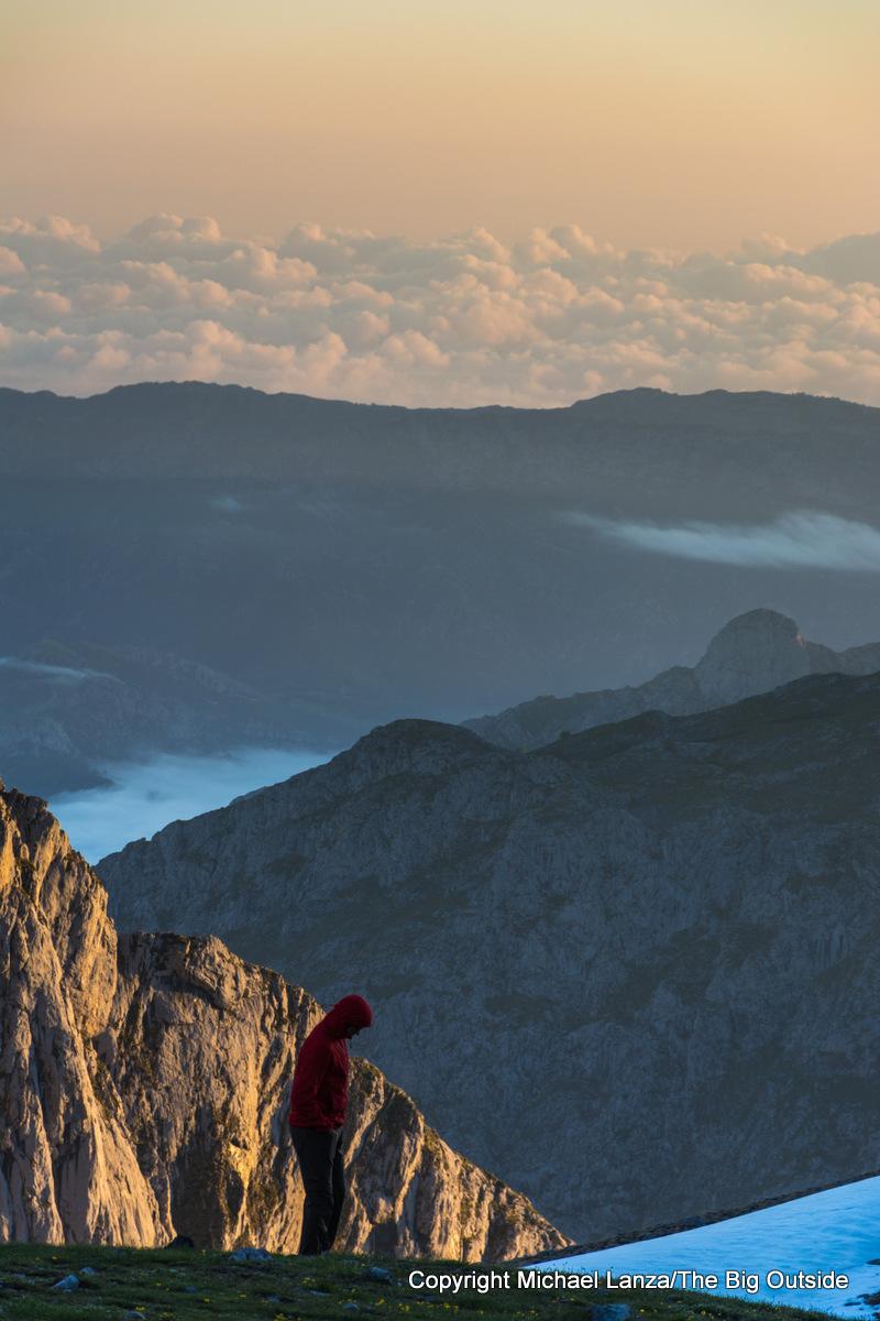 A hiker at dawn outside the Refugio Vega de Urriellu in Spain's Picos de Europa National Park.