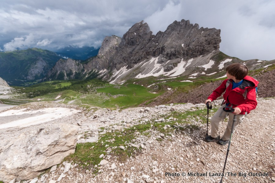 A young teenage boy hiking to Forca Rossa on the Alta Via 2 in Italy's Dolomite Mountains.