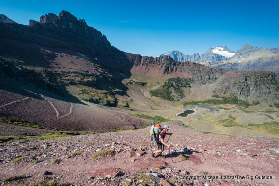 A backpacker on the Redgap Pass Trail in Glacier National Park.