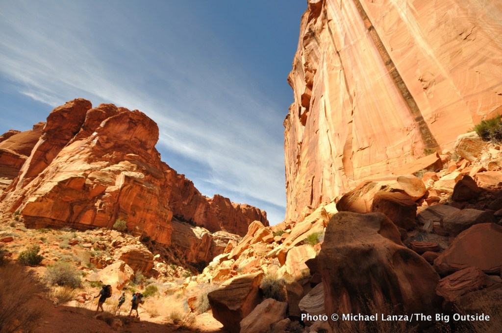 A family backpacking Chimney Rock Canyon in Capitol Reef National Park.