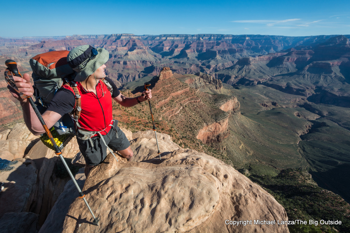 A backpacker standing at Ooh-Ah Point on the Grand Canyon's South Kaibab Trail.