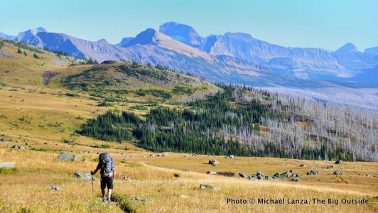 A backpacker on the northern Highline Trail in Glacier National Park.