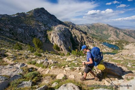 A backpacker above Overland Lake on the Ruby Crest Trail, Ruby Mountains, Nevada.