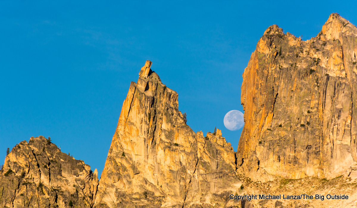 The moon and spires above Baron Lake in Idaho's Sawtooth Mountains.