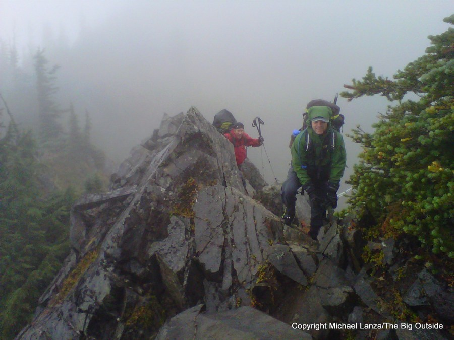 Backpackers hiking in rain in the Bailey Range, Olympic National Park.