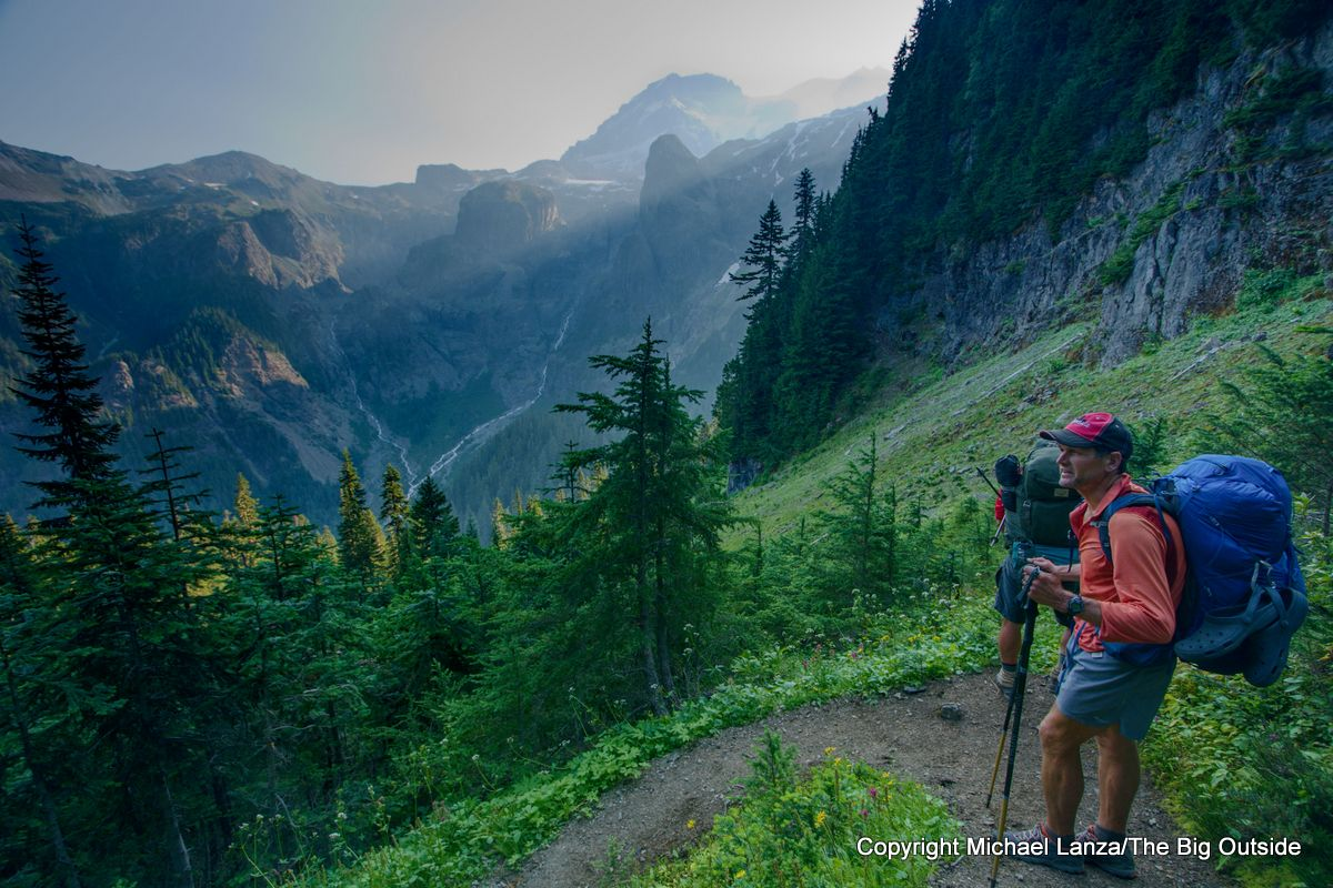 Backpackers above the North Puyallup River on the Wonderland Trail, Mount Rainier National Park.