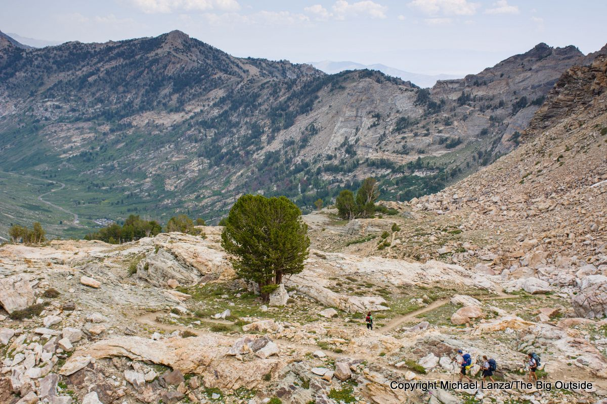 Backpackers descending to Lamoille Canyon on the Ruby Crest Trail, Ruby Mountains, Nevada.