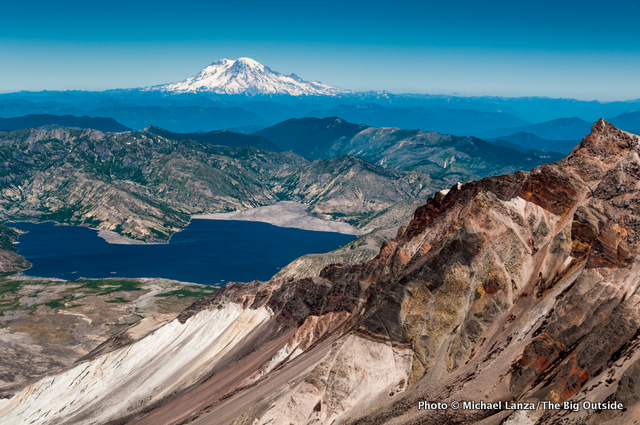 The crater rim of Mount St. Helens with Mount Rainier in the distance.