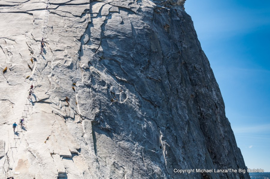 Hikers on Half Dome's cable route in Yosemite National Park.