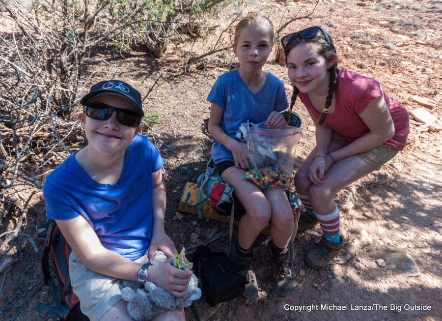 Young girls snacking while hiking in the Needles District of Canyonlands National Park.