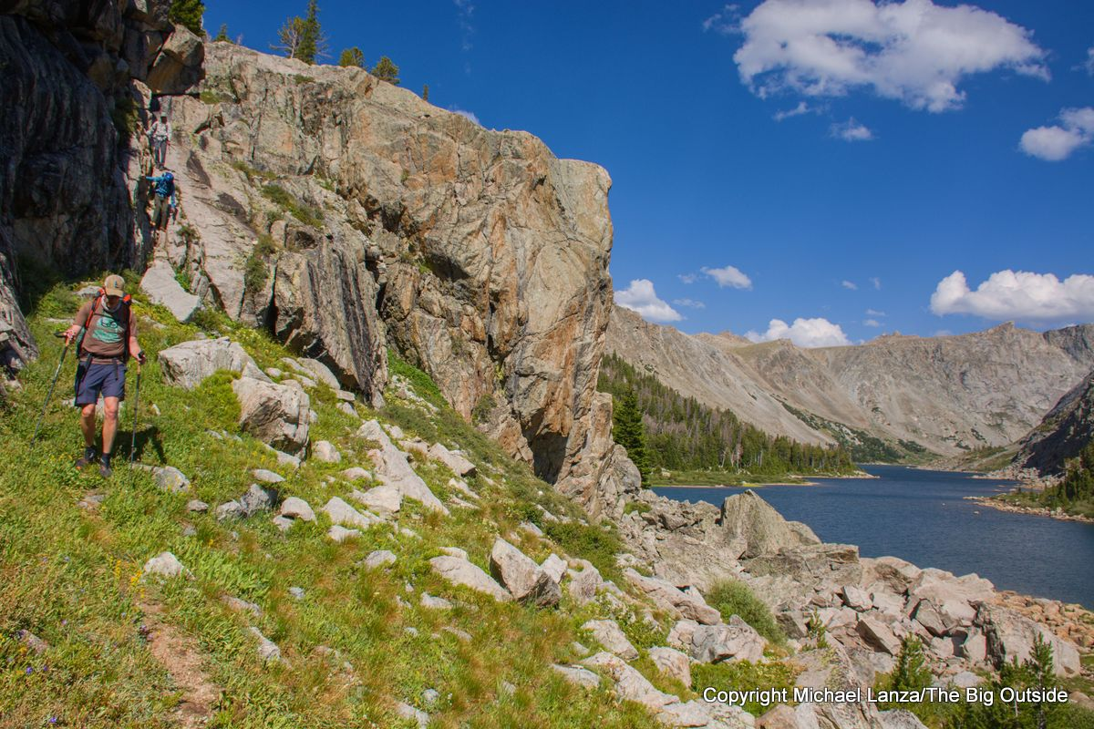A backpacker passing Black Joe Lake on the Wind River High Route.