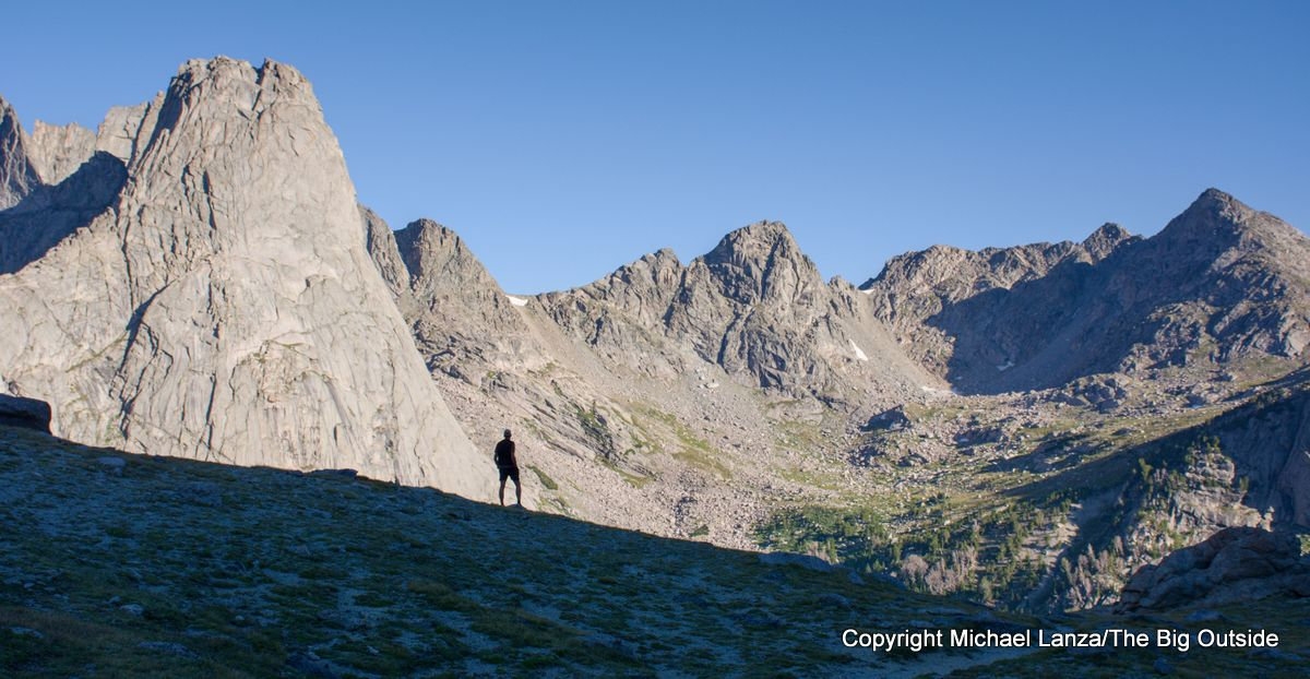 A backpacker below Jackass Pass, overlooking the Cirque of the Towers in the Wind River Range.