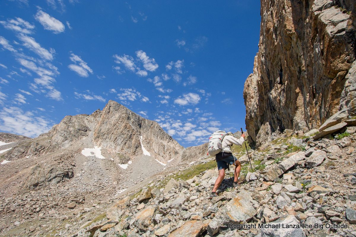 A backpacker hiking to Douglas Peak Pass on the Wind River High Route.