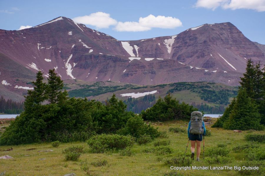 A backpacker hiking Chain Lakes Atwood Trail 43 toward Trail Rider Pass in Utah's High Uintas Wilderness.